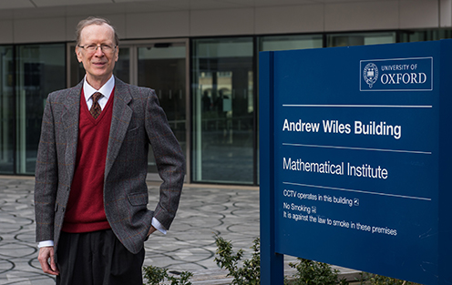 Andrew Wiles outside the Mathematical Institute at Oxford University, the building is named in his honour.